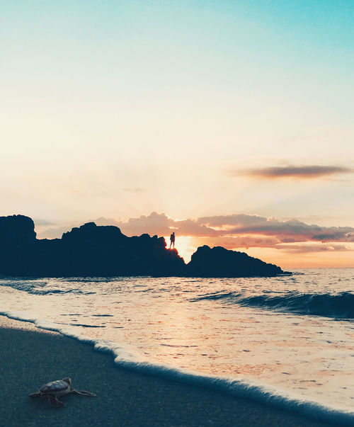 Beach Beauty In Nature Day Leisure Activity Lifestyles Men Mountain Nature One Person Outdoors People Real People Scenics Sea Sky Sunset Water Wave
