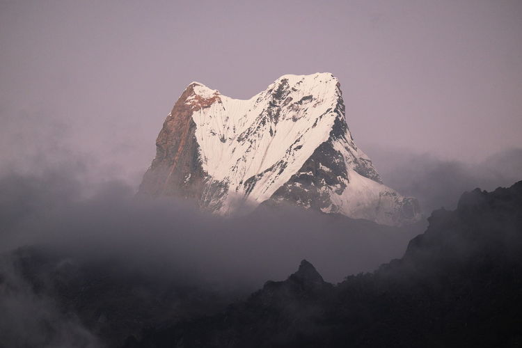Machapuchare peak at dusk Mist Mountain Peak Outdoors Nature Beauty In Nature Peak Annapurna Expedition Adventure Nepal Sunset Dusk Alpinism Mountaineering Ascending Machapucharé Himalayas Sky Snowcapped Mountain Mountain Range Fog Mountain