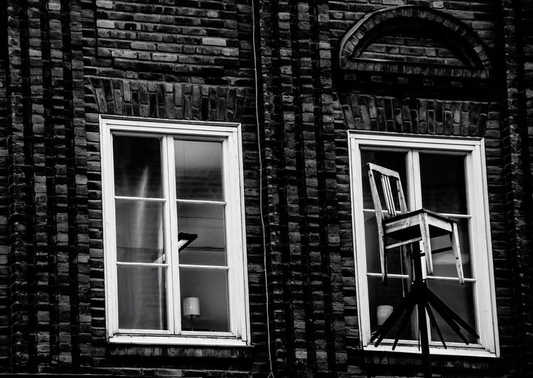Take a seat. Architecture Built Structure Window Building Exterior No People Day Outdoors Chair Chair In Sky Blackandwhite EyeEmNewHere Black And White Friday