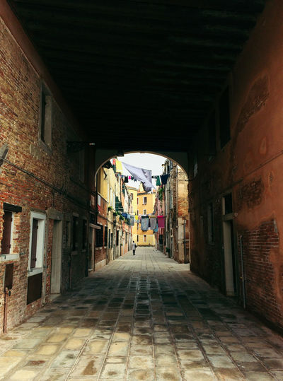 Empty alley along buildings