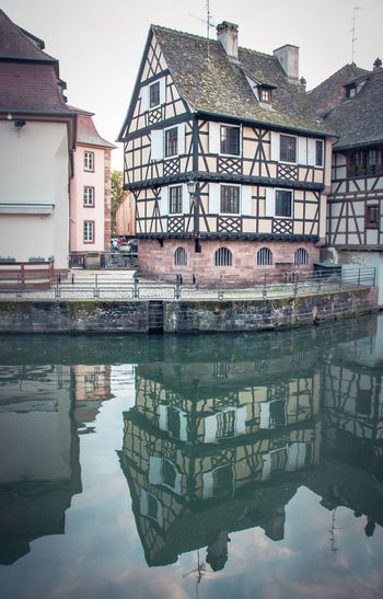 Architecture City Outdoors Reflection Built Structure Building Exterior Building Water Waterfront Residential District House Day Nature Sky No People Standing Water Travel Destinations Symmetry Petite France Typical Houses Half-timbered Half-timbered Houses Reflection Channel