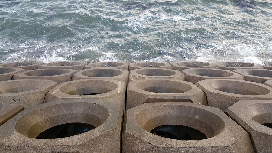 Concrete Blocks Holes Sea Wall Outdoors Sea Sea Defence Water Waves