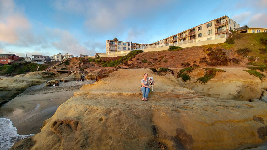 Ocean Beach San Diego Sunset Architecture Building Exterior Built Structure Casual Clothing Cloud - Sky Day Full Length Leisure Activity Lifestyles Nature One Person Outdoors Real People Rock Rock - Object Sky Solid Standing Women