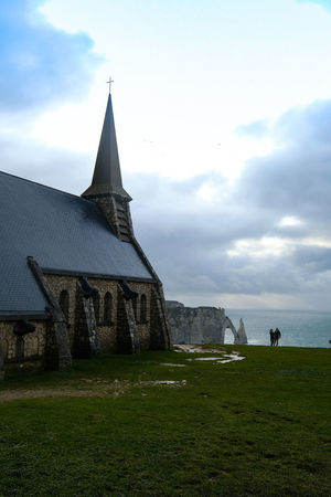 Sky Built Structure Cloud - Sky Architecture Building Exterior Grass Religion Place Of Worship Nature Land Belief Building Field Spirituality Plant Tower Day Outdoors Spire  étretat
