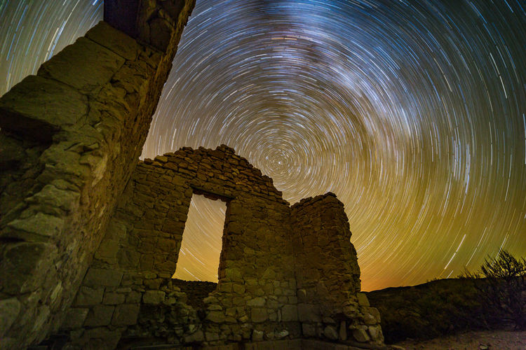 Dancing over the gentle ruin | Stars came out and danced around the North Star across the sky over the deserted old mining camp, as they did during the Gold Rush. All there is left now is the gentle ruin of what could've been and the relics of the dashed dreams. Paletto, NV Adventure Astronomy Astrophotography Debris Desert Galaxy High Desert Landscape Landscape Photography Light Pollution Nevada Night Night Photography Night Sky Old Mining Camp Outdoors Paletto Road Trip Ruins Star Trail Stargazig Start Trails The Milky Way Travel Window
