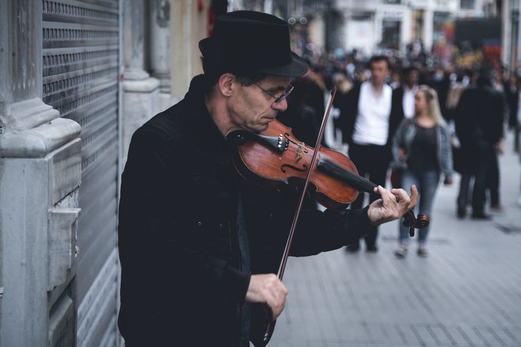 Violinist no:3 One Man Only One Person Adult Music Arts Culture And Entertainment Musical Instrument Musician Men Day Performance Violin Street Musicians Turkey Istanbul Playing Music City Outdoors Street Photography Art Is Everywhere Violinist Streetphotography The Street Photographer - 2017 EyeEm Awards