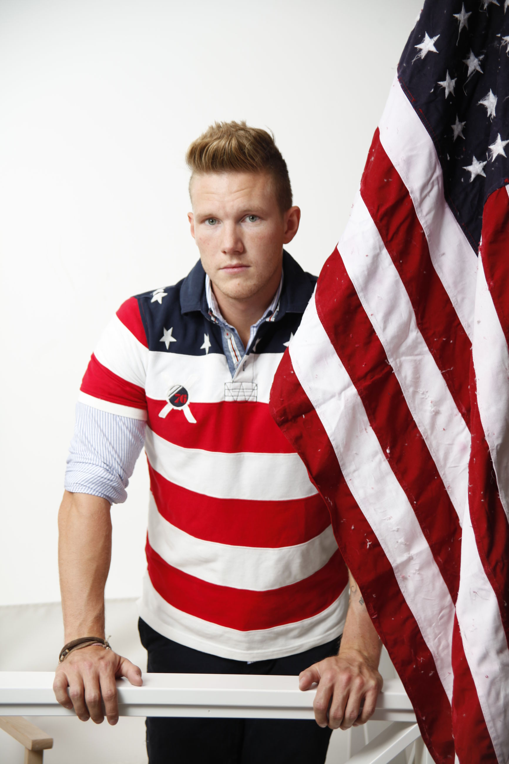lifestyles, casual clothing, leisure activity, person, front view, young men, standing, patriotism, red, three quarter length, striped, looking at camera, young adult, smiling, flag, national flag, men
