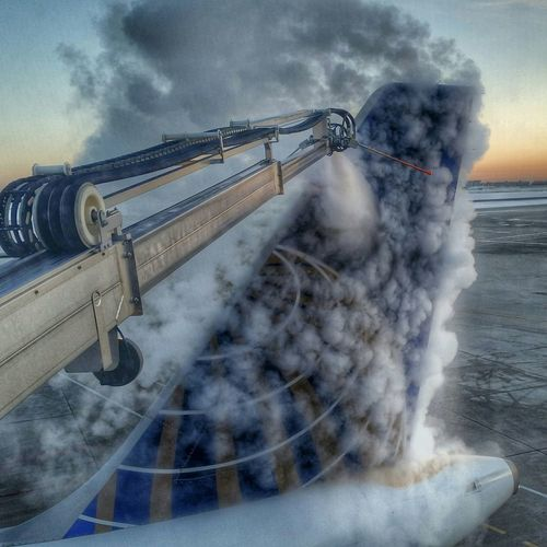 De-icing airplane at airport