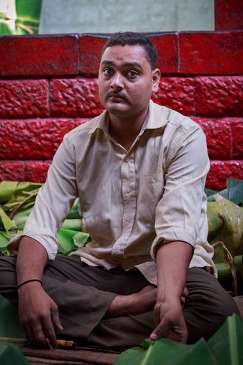 The Banana Leaf Merchant. Pune, India. One Person Sitting Adults Only Front View Market Market Stall Portrait Real People Food Adult Only Men One Man Only Indoors  People Day Light And Reflection