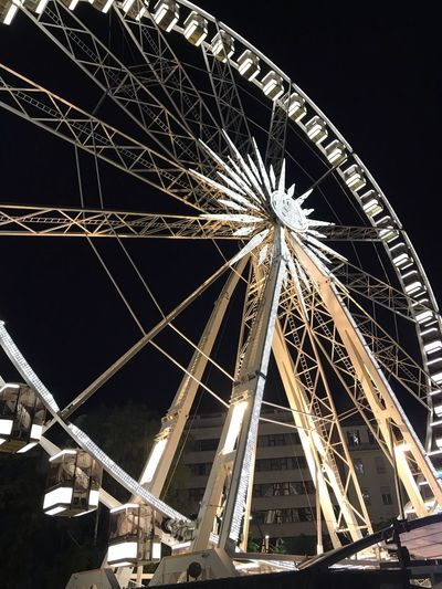 Low Angle View Night Architecture Sky Built Structure Amusement Park Ride Amusement Park Arts Culture And Entertainment Illuminated Ferris Wheel No People Clear Sky Outdoors Building Exterior Nature Tall - High Fairground Travel Destinations City Tourism