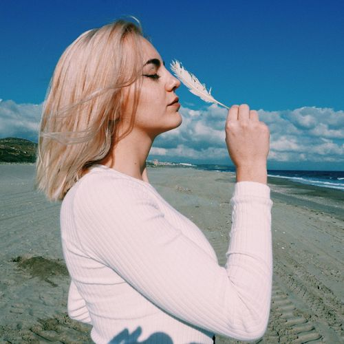 Water Sea Beach Blond Hair One Person Outdoors Sky Horizon Over Water Nature Day Real People Beauty In Nature Cold Temperature Young Adult Adults Only Human Hand Adult People