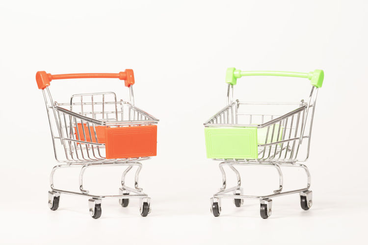 cart on white background Shopping Cart Shopping Studio Shot Retail  Supermarket Consumerism Empty No People Indoors  Cut Out White Background Copy Space Store Metal Cart Buying Push Cart Business Green Color Shopping Basket Sale Wheel