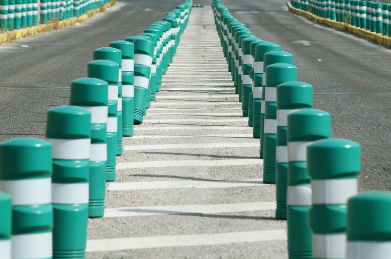 street bollards in Madrid ©alexander h. schulz Bollards Centered Day Green Color Horizontal In A Row Lane Markers No People Outdoors Plastic Poller Security SPAIN Street Stripes Traffic Transportation