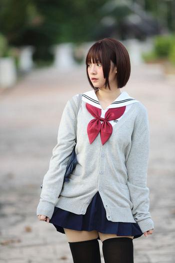Young Woman In School Uniform