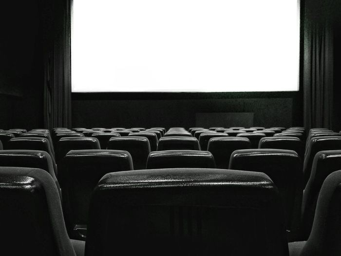 Blackandwhite Black And White Black & White Blackandwhite Photography MOVIE Entertainment Enjoying Life Chair Film Industry Arts Culture And Entertainment No People Cinema Darkness Illuminated Film Hollywood Indoors  Auditorium Bnw Blackandwhite Cool Alone Seat Abundance Day Be. Ready. Indoors  Movie Theater Empty In A Row HUAWEI Photo Award: After Dark A New Beginning Capture Tomorrow