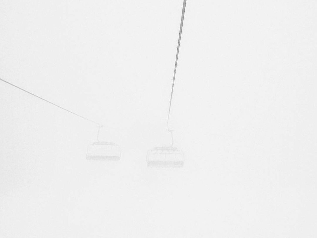 SNOW COVERED OVERHEAD CABLE CAR IN WINTER
