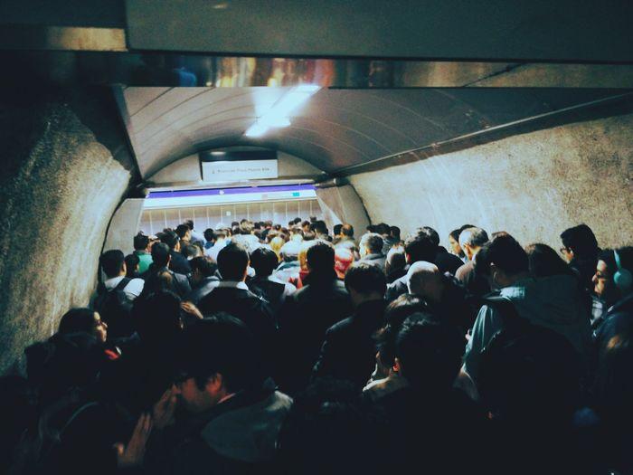 Crowd in illuminated corridor