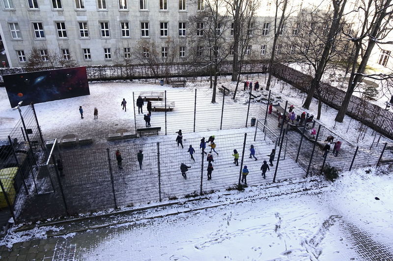 Schulhof im Winter Schoolyard Schulhof Architecture Building Exterior Built Structure City Cold Temperature Competitive Sport Day Frozen High Angle View Ice Rink Ice Skate Large Group Of People Leisure Activity Lifestyles Men Outdoors Real People Snow Sport Water Winter Winter Sport