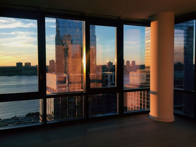 EyeEm Selects Architecture Skyscraper Built Structure City Building Exterior Window Sunset Sky Cityscape Modern Urban Skyline Indoors  Cloud - Sky Downtown District Sunlight Travel Destinations Day Architectural Column No People Water Hudson River New York City NYC Upper West Side