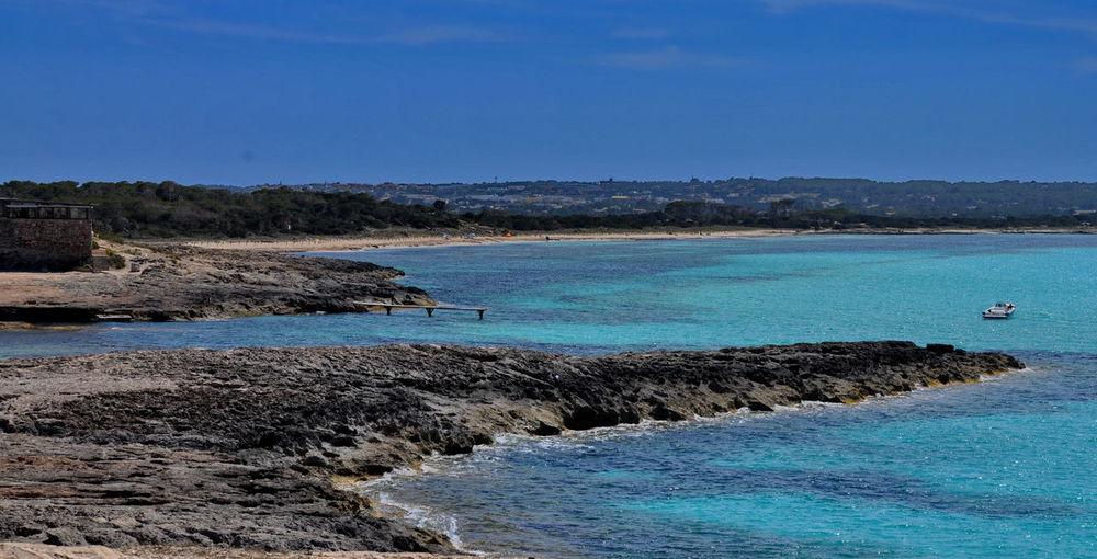 Beach Balearic Islands Beauty In Nature Blue Calm Coastline Formentera Mediterranean Sea Nature No People Outdoors Pitiusa Platja Des Pujols Sea Water Scenics Clear Sky Landscape Day