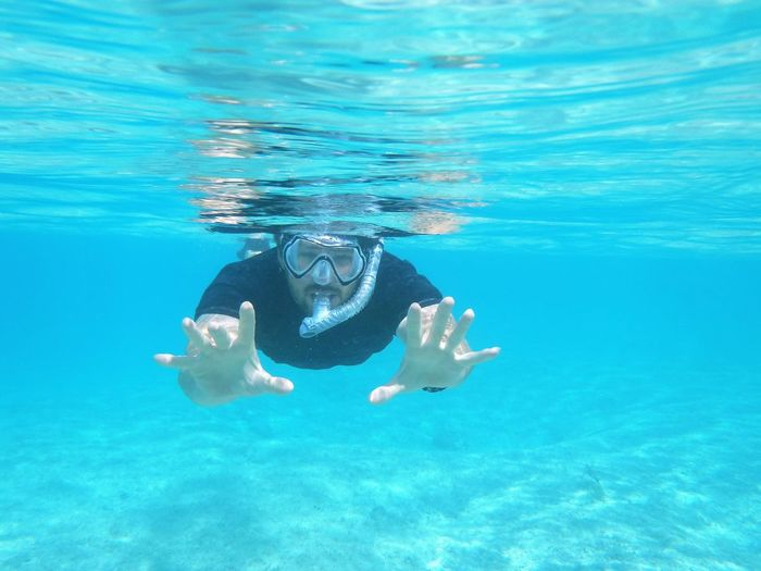 Portrait of man snorkeling underwater