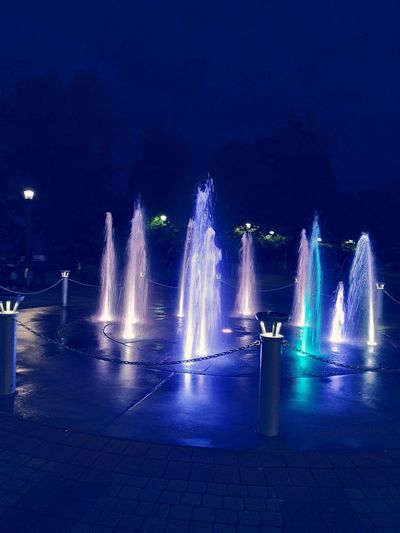 Illuminated fountain at night