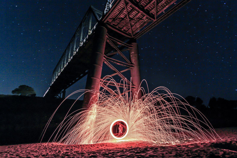 Branch Bridge Illuminated Long Exposure Motion Nature Night No People Outdoors Sand Sky Spark Spinning Spinning Steel Wool Stars Steel Structure  Underneath Wire Wool The Week On EyeEm The Week On EyeEm