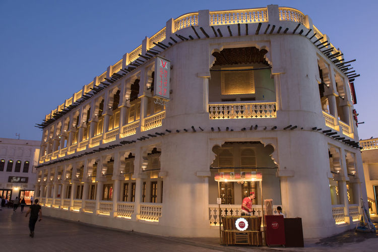 Souq Waqif Doha Souq Arch Architecture Building Building Exterior Built Structure City Clear Sky Dusk Group Of People History Illuminated Incidental People Motion Nature Outdoors Qatar Sky Souk Waqif The Past Tourism Travel Travel Destinations Waqif