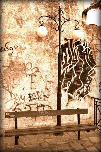 Bench Lantern Street Lamp Bulb Cobblestone Day Grafffiti Art Kavala Greece Sepia Streetart