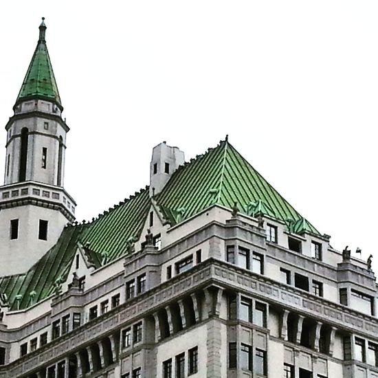 Patina roof on historical apartment building. Architecture Building Exterior Built Structure Low Angle View Religion Clear Sky Window High Section Place Of Worship Church City Dome Arch Outdoors Sky Day Green Color No People Spire  Façade Gargoyles Patina