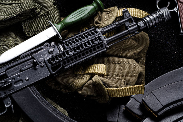 High angle view of gun on backpack