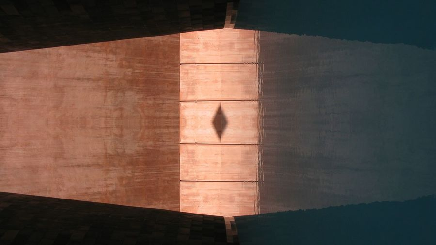 Wooden structure reflecting on water