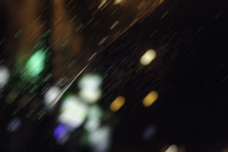 Car Lights Motion Blur Rain RainDrop Blurred Motion Bokeh Bokeh Photography Car Car Window Digital Blur Drop Focus On Foreground Illuminated Ilumination Motion Nature Night No People Outdoors Rain On Car Rain On Car Window Rain On Window Selective Focus Water Window