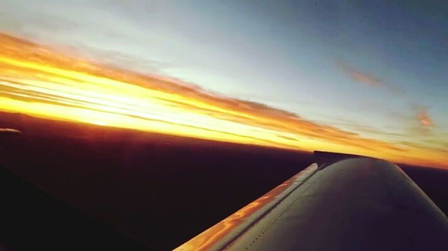 The beautiful African sun sitting on the endless plain of Earth!. Sunset Birdeyeviewphotography Aircraft Wing Travel Charter Plane Aerial View Serenity Air Vehicle Scenics Day Mid-air