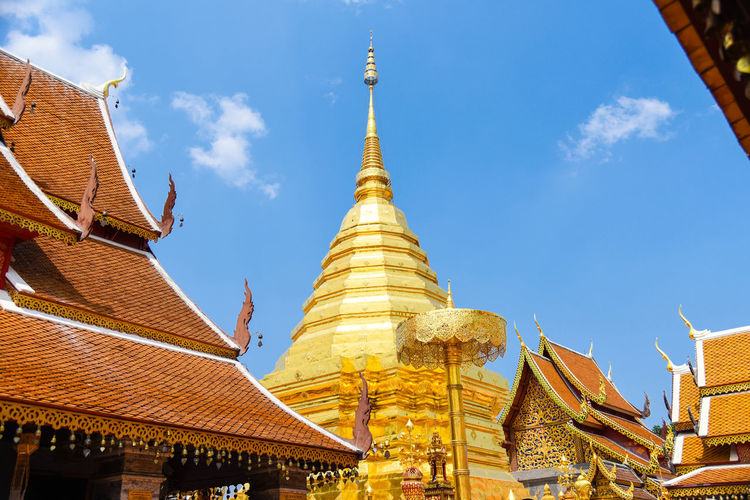 Low angle view of pagoda against buildings,wat phra that doi suthep chiang mai thailand.