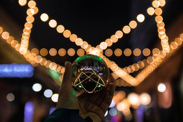 Bokeh swirls Christmas Market Toronto Bokeh Canada Celebration Close-up Crystal Ball Photography Distillery District Holding Human Body Part Human Hand Illuminated Lensball Night One Person Outdoors