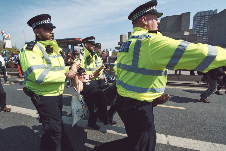 Extinction Rebellion - London 2019 Extinction Rebellion Protest Protesters London Clothing Real People Day Reflective Clothing Safety Men Group Of People Sunlight Street City Nature People Road Occupation Standing Young Men Incidental People Outdoors Uniform Coworker