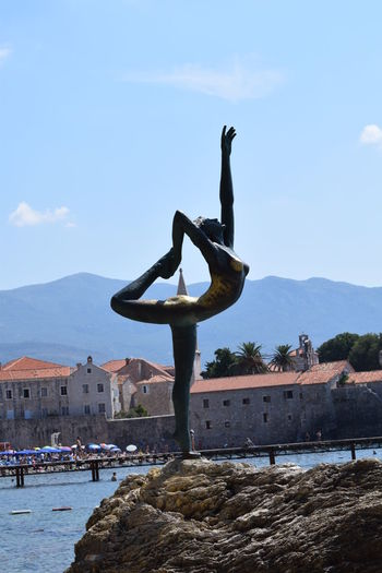 Budva Budva Bay Budva,Montenegro Statue Of The Budva Dancer Architecture Art And Craft Building Exterior Built Structure City Day Leisure Activity Lifestyles Men Mountain Nature Outdoors People Sculpture Sky Statue Water