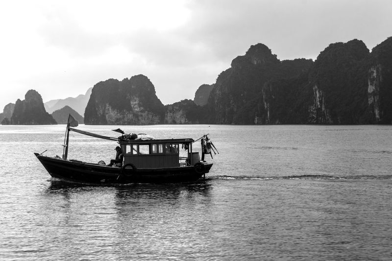 Vietnam Halong Bay Beauty In Nature Day Men Mode Of Transport Mountain Nature Nautical Vessel Outdoors People Real People Sailing Scenics Sea Sky Tranquility Transportation Tree Water Waterfront