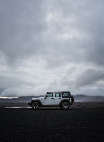 Jeep Wrangler in Iceland Cloudy Jeep Life Black Car Cloud - Sky Clouds Day Jeep Jeep Wrangler  Land Vehicle Landscape Nature No People Outdoors Road Sky Still Life Transportation White