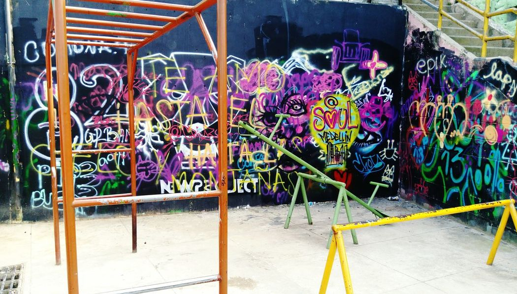 Graffiti Street Art Multi Colored Built Structure Day Architecture City No People Outdoors Comuna 13 Graffitour