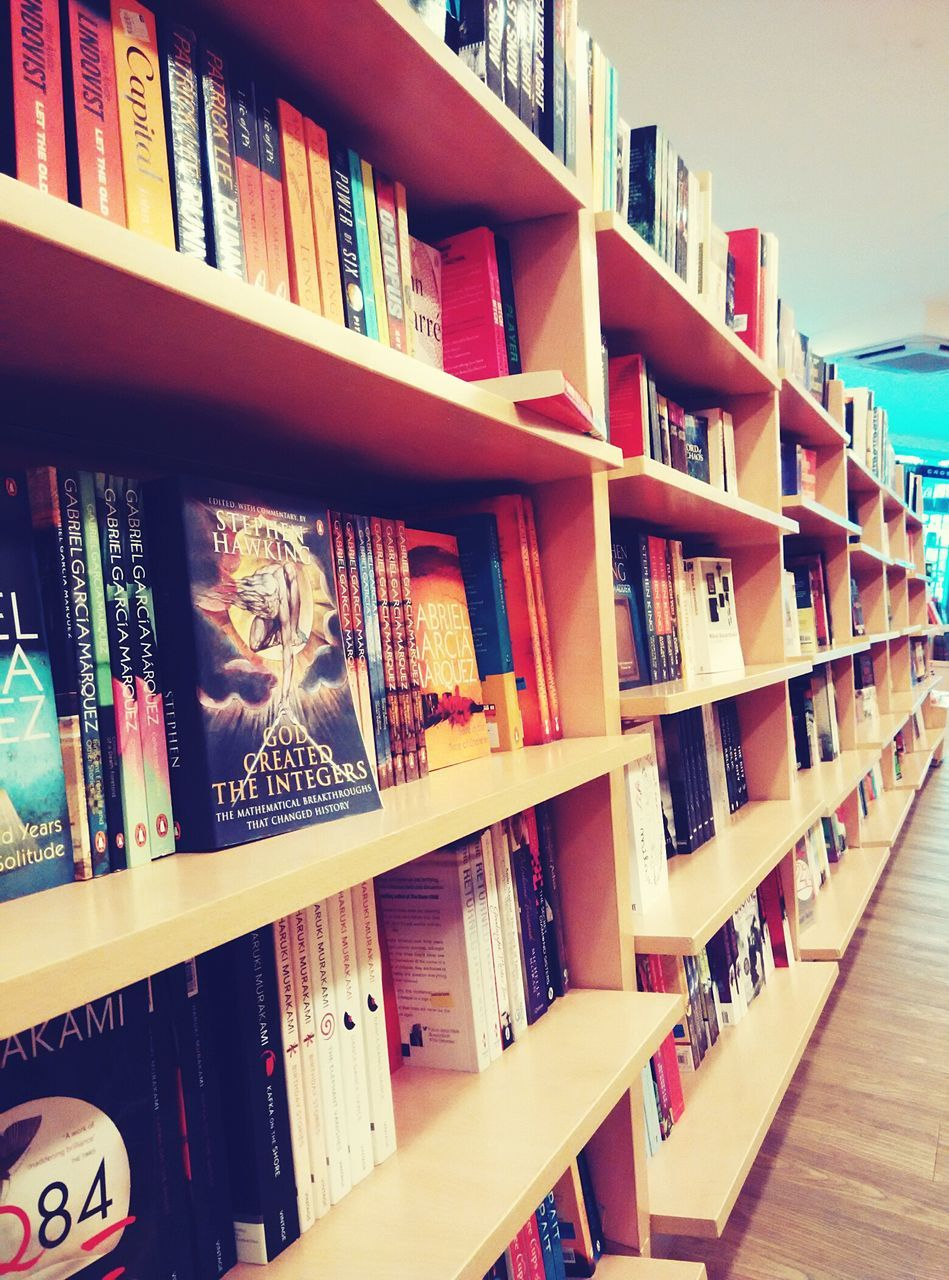 shelf, book, bookshelf, library, indoors, education, choice, wisdom, large group of objects, literature, no people, learning, day