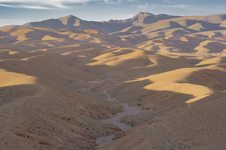 Scenics - Nature Environment Land Landscape Tranquility Desert Arid Climate Nature No People Sunlight Sand Sky Sand Dune Outdoors Riverbed Dry Riverbed Desert Landscape Expanse Dunescape Sand Dunes Tranquil Scene Climate Desert Beauty Day Sunset