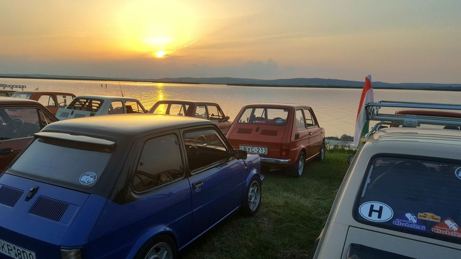 Fiat126 Fiat Little Cars On The Way Eye4photography  Eyeem Hungary Sunset Cars In The Sunset Lakeside Lake Velencei Velencei-tó Agárd Fiats Fiat In The Sunset Cars On The Lakeside Lake Life Camping Trip Cute Cars Polski Showcase July Showcase: July