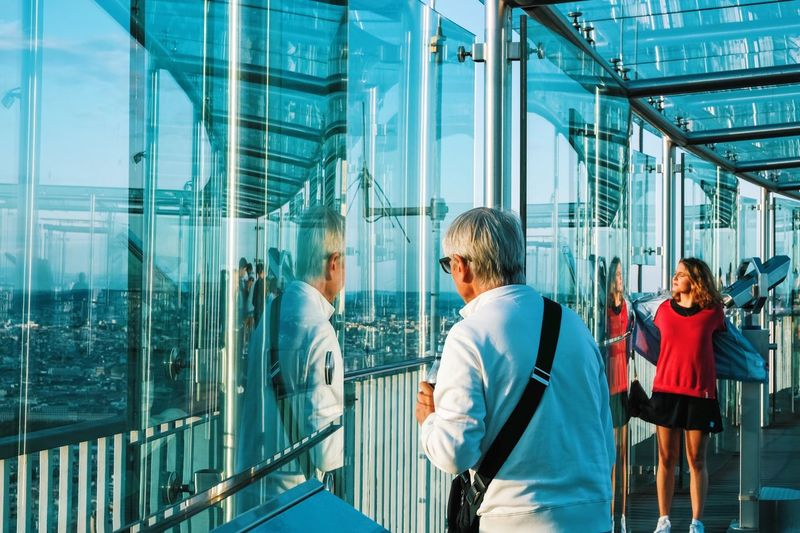 Rear view of people walking in modern building