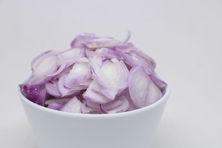 Close-up of purple flower in bowl