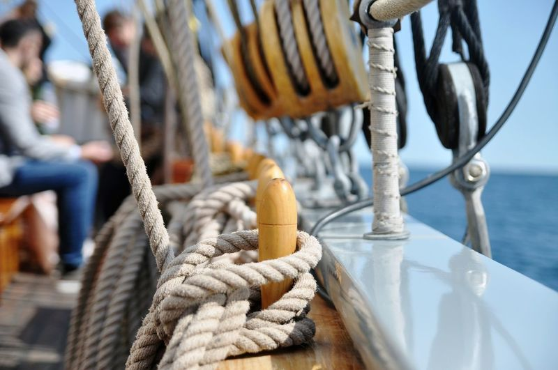 Close-up of ropes on boat in sea