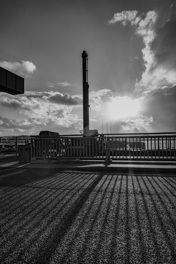 Abstract Black & White Built Structure Cardiff Bay Barrage Cloud Cloud - Sky Cloudy Day Empty Landscape Lens Flare No People Outdoors Railings Shadows Shooting Into The Sun Silhouette Sky Sun Sunbeam Sunlight Sunny Tranquil Scene Tranquility