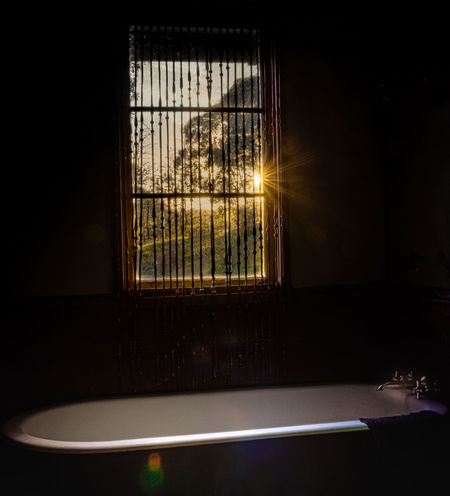 Indoors  Window No People Illuminated Sunset Bath Bathroom Claw Foot Bathtub Nature Starburst Sunrays Cottage Rural Country House Country Home Tree Trees Hills Calming Romantic Getaway  Nature Photography Vacation Peaceful Relaxing EyeEmNewHere Perspectives On Nature