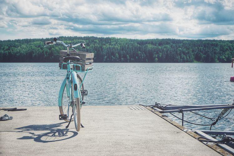 2019 Niklas Storm Juni Water Tree Bicycle Lake Stationary Sky Cloud - Sky Landscape Bicycle Rack Bicycle Basket Handlebar Calm Lakeside My Best Photo The Great Outdoors - 2019 EyeEm Awards The Traveler - 2019 EyeEm Awards